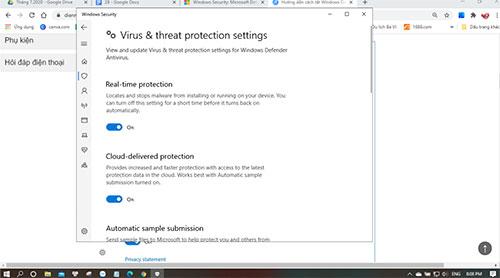 Mở cửa sổ Virus & Threat protection settings